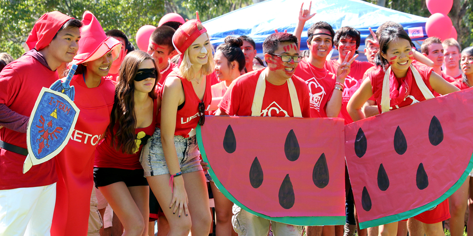 Group of happy students dressed up for an outdoor event