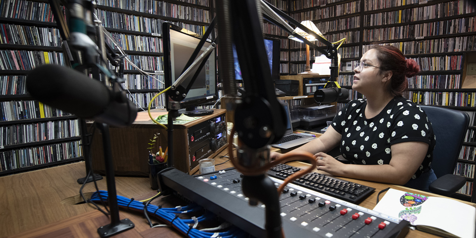 DJ in the KUCI studio